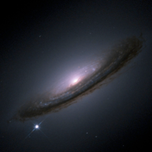 Figure: Supernova Eruption in the Galaxy NGC 4528 This supernova (lower left) erupted in 1994. Image credit: NASA/ESA/Hubble Key Project Team/High-Z Supernova Search Team